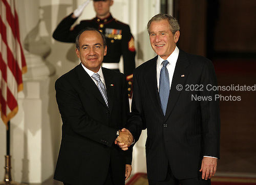 Washington, DC - November 14, 2008 -- United States President George W. Bush greets Felipe Calderon Hinojosa, President of Mexico to the White House for a working dinner at the start of the G20 Summit on Financial Markets and the World Economy. .Credit: Gary Fabiano - Pool via CNP