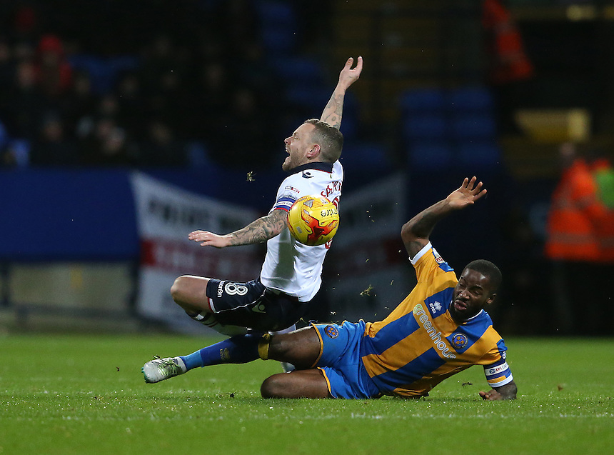 Bolton Wanderers' Jay Spearing is fouled by Shrewsbury Town's Abu Ogogo<br /> <br /> Photographer Stephen White/CameraSport<br /> <br /> The EFL Sky Bet League One - Bolton Wanderers v Shrewsbury Town - Monday 26th December 2016 - Macron Stadium - Bolton<br /> <br /> World Copyright &copy; 2016 CameraSport. All rights reserved. 43 Linden Ave. Countesthorpe. Leicester. England. LE8 5PG - Tel: +44 (0) 116 277 4147 - admin@camerasport.com - www.camerasport.com