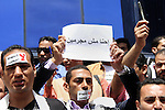 News photographers and Journalists shout slogan as they protest in front of the journalists' syndicate in Cairo, Egypt, 17 April 2014. Dozens of Egyptian journalists rallied in Cairo on 17 April to demand protection after several colleagues were killed and injured while covering the country's political unrest. The rally comes three days after two photojournalists were injured while covering clashes near Cairo University between security forces and students backing deposed Islamist president Mohamed Morsi. Last month a reporter died of gunshot wounds suffered during clashes between security forces and pro-Morsi protesters in eastern Cairo. Photo by Mohammed Bendari