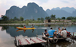 Tourist lounge along Nam Song in Vang Vieng, Laos on Tuesday, March 4, 2008.  (photo by Khampha Bouaphanh)