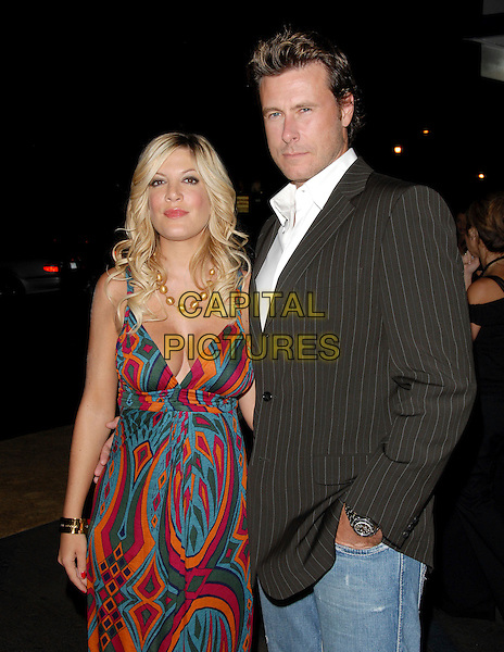 "TORI SPELLING & DEAN McDERMOTT.Mark Burnett & AOL's Launch of ""Gold Rush"" interactive reality competition held at Les Deux in Hollywood, California, USA..September 12th, 2006.Ref: DVS.half length fuschia blue turquoise mulitcoloured pattern dress purple orange blue married couple husband wife black pinstripe suit jacket.www.capitalpictures.com.sales@capitalpictures.com.©Debbie VanStory/Capital Pictures"