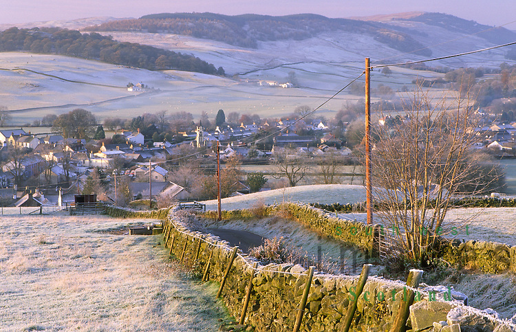 A frosty misty winter morning looking down on the small of village of Moniaive Dumfries and Galloway Scotland UK