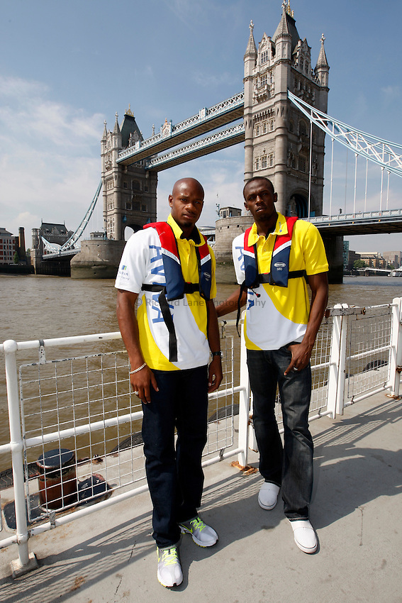 Photo: Richard Lane/Richard Lane Photography. Photocall on the River Thames, London ahead of The Aviva London Grand Prix. 24/07/2008.  Jamaician sprinters, Asafa Powell and Usain Bolt at Tower Bridge.