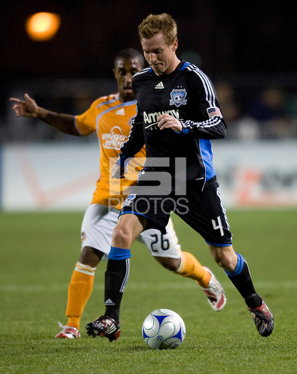 28 March 2009: Chris Leitch of Earthquakes dribbles the ball away from Corey Ashe of Dynamo during the game at Buck Shaw Stadium in Santa Clara, California.  San Jose Earthquakes defeated Houston Dynamo, 3-2.