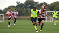 Mads Bech Sorensen of Brentford B's holds onto Huddersfield Town's Colin Quaner during Brentford B vs Huddersfield Town Under-23, Friendly Match Football at Brentford FC Training Ground, Jersey Road on 12th September 2018