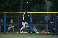 Salem-Keizer Volcanoes right fielder Dalton Combs (31) leaps at the wall before making a catch during a Northwest League game against the Hillsboro Hops at Ron Tonkin Field on September 1, 2018 in Hillsboro, Oregon. The Salem-Keizer Volcanoes defeated the Hillsboro Hops by a score of 3-1. (Zachary Lucy/Four Seam Images)