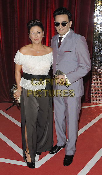 Jessie Wallace & Tim Arnold.attended the British Soap Awards 2013, Media City, Salford, Manchester, England, UK, 18th May 2013..full length black off the shoulder shoulders white top black belt sash trousers slit split wide leg sunglasses grey gray suit tie  clutch bag .CAP/CAN.©Can Nguyen/Capital Pictures.