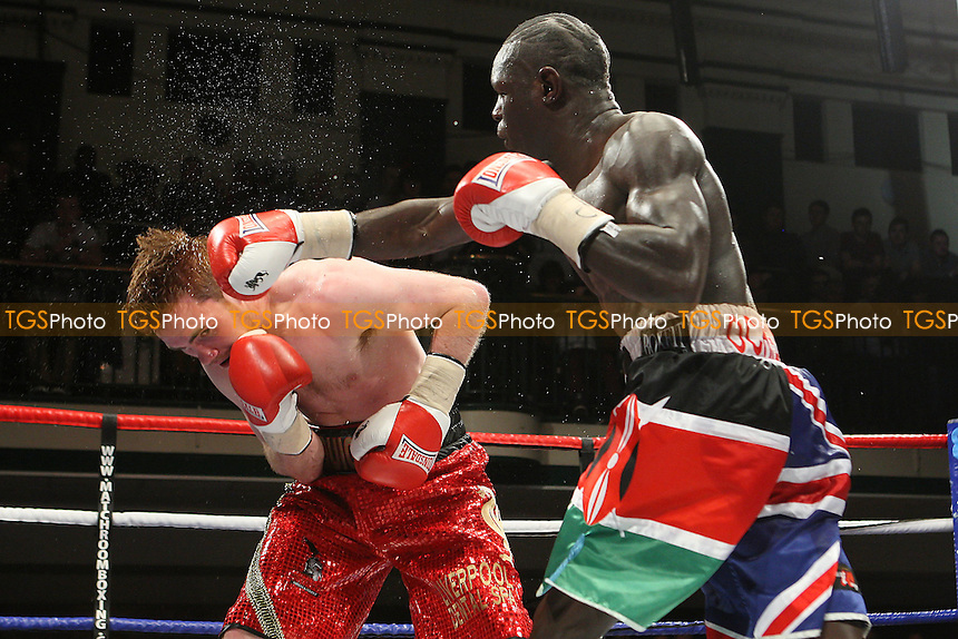 Erick Ochieng (multi-coloured shorts) defeats Nick Quigley in a Light-Middleweight boxing contest for the English Title at York Hall, Bethnal Green, promoted by Matchroom Sports - 28/01/12 - MANDATORY CREDIT: Gavin Ellis/TGSPHOTO - Self billing applies where appropriate - 0845 094 6026 - contact@tgsphoto.co.uk - NO UNPAID USE.