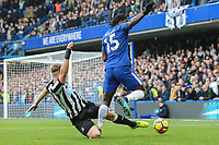 Victor Moses of Chelsea (15) is tackled by Matt Ritchie of Newcastle United (left) during the Premier League match between Chelsea and Newcastle United at Stamford Bridge, London, England on 2 December 2017. Photo by David Horn.