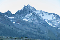 A hiker, in the dawn light, stands in front of Mont Blanc on the TMB, near the Auberge du Truc, on the Col du Tricot section of the Tour du Mont-Blanc. September 2007