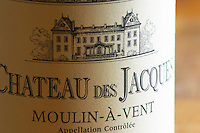 Closeup close-up of a wine bottle label Maison Louis Jadot Bourgogne Chateau des Jacques Moulin-a-Vent Beaujolais Appellation Controlee with an engraving of the chateau building, Maison Louis Jadot, Beaune Côte Cote d Or Bourgogne Burgundy Burgundian France French Europe European