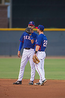 AZL Rangers shortstop Obie Ricumstrict (66) talks to second baseman Ryan Dorow (28) during a pitching change against the AZL Padres 2 on August 2, 2017 at the Texas Rangers Spring Training Complex in Surprise, Arizona. Padres 2 defeated the Rangers 6-3. (Zachary Lucy/Four Seam Images)