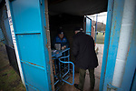A spectator pays in at the turnstile before Cambrian and Clydach Vale take on Cwmbran Celtic at King George's New Field in a Welsh League Division One match, the top division of the Welsh Football League and the second level of the Welsh football league system. The club, formed in 1965 reached the final of the 2018-19 League Cup final and can count on ex-England manager Terry Venables as a former club chairman. Cambrian and Clydach Vale won this match 2-0, watch by a crowd of around 100 spectators.