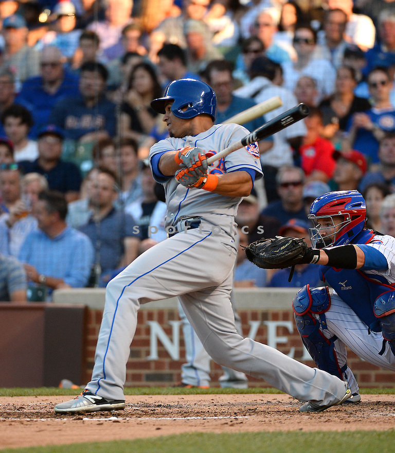New York Mets Juan LaGares (12) during a game against the Chicago Cubs on July 18, 2016 at Wrigley Field in Chicago, IL. The Cubs beat the Mets 5-1.