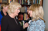 09 March 2016 - London, England - Camilla Duchess of Cornwall, President of WOW, speaks with journalist Rachel Johnson at a reception for the Women of the World Festival (WOW) at Clarence House, in central London. Photo Credit: Alpha Press/AdMedia