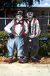 Free standing painting of Elbo and Buzzy in front of the elementary school in Lake Placid