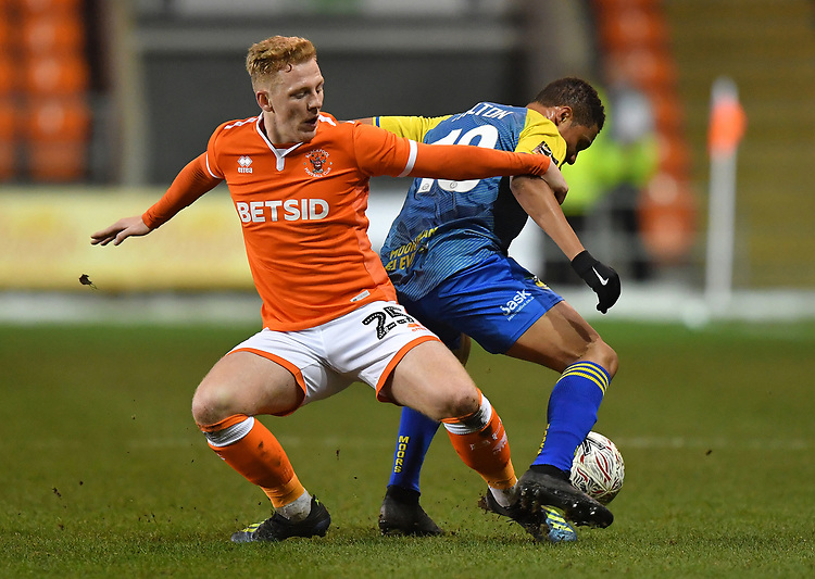Blackpool's Callum Guy battles with Solihull Moors' Jermaine Hylton<br /> <br /> Photographer Dave Howarth/CameraSport<br /> <br /> The Emirates FA Cup Second Round Replay - Blackpool v Solihull Moors - Tuesday 18th December 2018 - Bloomfield Road - Blackpool<br />  <br /> World Copyright © 2018 CameraSport. All rights reserved. 43 Linden Ave. Countesthorpe. Leicester. England. LE8 5PG - Tel: +44 (0) 116 277 4147 - admin@camerasport.com - www.camerasport.com