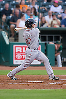 J.T. Watkins (10) of the Greenville Drive follows through on his swing against the Greensboro Grasshoppers at NewBridge Bank Park on August 17, 2015 in Greensboro, North Carolina.  The Drive defeated the Grasshoppers 5-4 in 13 innings.  (Brian Westerholt/Four Seam Images)