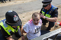 Police mount a large operation in Cambridge to keep around 35 Free Tommy Robinson demonstrators apart from several hundred anti fascists holding a counter protest. 22-7-18 A Tommy Robinson supporter is arrested for throwing some red paint or dye over police.