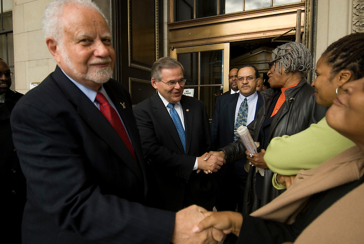 Sen. Robert Menendez, D-N.J., center, walks down the steps of the East Orange, N.J. City Hall with African-American New Jersey mayors who have endorsed him on their way to a rally in front of the building on Thursday, Oct. 26, 2006. To the left is East Orange, N.J., mayor Robert Bowser.