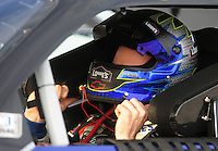Nov. 20, 2009; Homestead, FL, USA; NASCAR Sprint Cup Series driver Jimmie Johnson during qualifying for the Ford 400 at Homestead Miami Speedway. Mandatory Credit: Mark J. Rebilas-