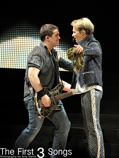 "Wolfgang Van Halen  and David Lee Roth of Van Halen perform at the KFC Yum! Center on the opening night of the ""A Different Kind of Truth"" tour on February 18, 2012."