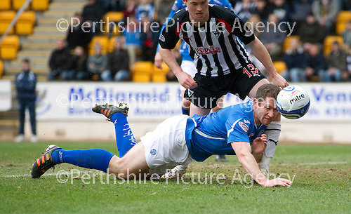 St Johnstone v Dunfermline....25.02.12   SPL.Frazer Wright gets a knee in the head from Paddy Boyle as he dives in for a header.Picture by Graeme Hart..Copyright Perthshire Picture Agency.Tel: 01738 623350  Mobile: 07990 594431