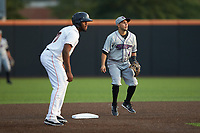 Nick Madrigal (4) of the Winston-Salem Dash keeps Bryan De La Cruz (10) of the Buies Creek Astros close to second base at Jim Perry Stadium on August 15, 2018 in Buies Creek, North Carolina.  The Astros defeated the Dash 5-0.  (Brian Westerholt/Four Seam Images)