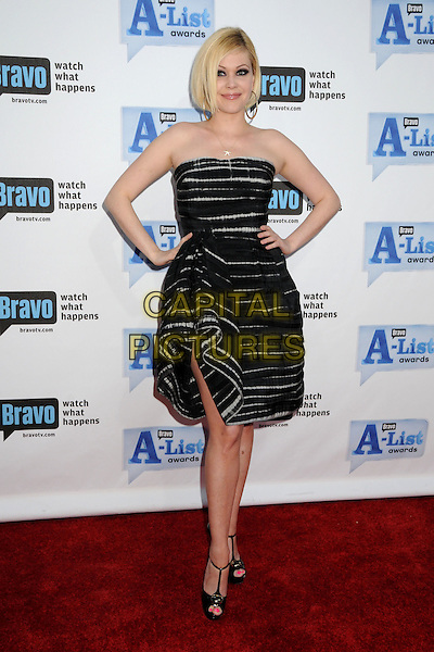 "SHANNA MOAKLER.Bravo's 2nd Annual ""The A-List Awards"" held at The Orpheum Theatre, Los Angeles, CA, USA..April 5th, 2009.full length black dress strapless hands on hips beige striped stripes pattern peep toe t-bar shoes .CAP/ADM/BP.©Byron Purvis/AdMedia/Capital Pictures."