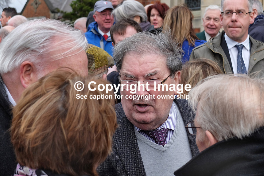John Hume, retired politician, former leader of the SDLP, former deputy first minister in the N Ireland Assembly, leaving Pennyburn Chapel, chatting with fellow attendees after attending the funeral mass of retired local press photographer, Larry Doherty, 6th March 2015. 201503060489<br />