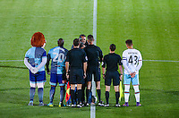 The Captains & officials are photographed with the matchday mascot during the The Checkatrade Trophy match between Wycombe Wanderers and West Ham United U21 at Adams Park, High Wycombe, England on 4 October 2016. Photo by Andy Rowland.