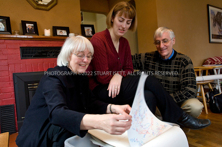 2/15/2008--Olympia, WA, USA..Rachel Corrie's parents, Cindy (left, 60) and Craig Corrie (right, 61), as well as her older sister Sarah Corrie Simpson (center, 34), dig through a box containing Rachel's notes, art work and journals in Sarah's home in Olympia, Washington State...Rachel Corrie killed on March 16, 2003 in Gaza, close to the border with Egypt while trying to obstruct a Caterpillar D9 armoured bulldozer, operated by the Israel Defense Forces (IDF). The circumstances and the question of responsibility for her death remain controversial..©2008 Stuart Isett. All rights reserved.