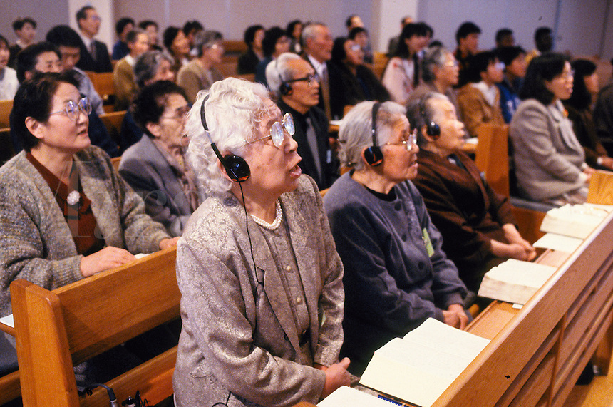 In keeping with Japanese traditions of respect, a church in Nagano, Japan, reserves the front rows for the elderly and provides headphones for the hearing impaired. old people. Nagano, Japan Christian church.