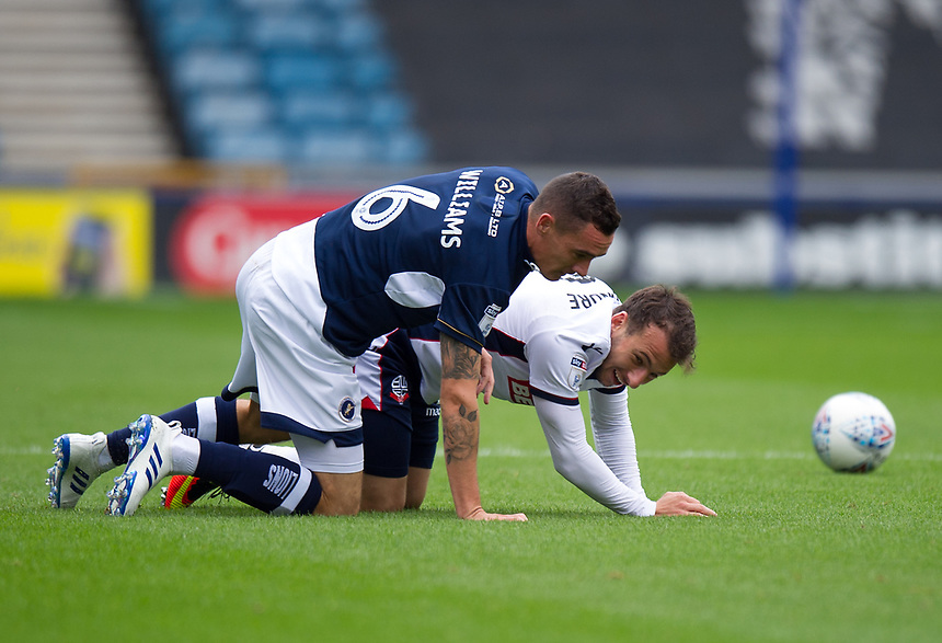 Bolton Wanderers' Adam Le Fondre battles for possession with Millwall's Shaun Williams<br /> <br /> Photographer Ashley Western/CameraSport<br /> <br /> The EFL Sky Bet Championship - Millwall v Bolton Wanderers - Saturday August 12th 2017 - The Den - London<br /> <br /> World Copyright &not;&copy; 2017 CameraSport. All rights reserved. 43 Linden Ave. Countesthorpe. Leicester. England. LE8 5PG - Tel: +44 (0) 116 277 4147 - admin@camerasport.com - www.camerasport.com