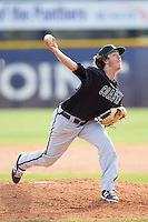 Coastal Carolina Chanticleers relief pitcher Chase Adkins (9) in action against the High Point Panthers at Willard Stadium on March 15, 2014 in High Point, North Carolina.  The Chanticleers defeated the Panthers 1-0 in the first game of a double-header.  (Brian Westerholt/Four Seam Images)