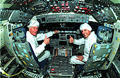 United States Senator John H. Glenn, Jr. (Democrat of Ohio), left, enjoys a tour of the flight deck in the orbiter Columbia with Astronaut Stephen Oswald at the Orbiter Processing Facility 3 at Kennedy Space Center on January 21, 1998.  Senator Glenn arrived at KSC on Jan. 20 to tour KSC operational areas and to view the launch of STS-89 later this week. Glenn, who made history in 1962 as the first American to orbit the Earth, completing three orbits in a five-hour flight aboard Friendship 7, will fly his second space mission aboard Space Shuttle Discovery this October. Glenn is retiring from the Senate at the end of this year and will be a payload specialist aboard STS-95..Credit: NASA via CNP