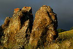 Dark storm clouds over lichen covered rocks at sunset, Mount Diablo State Park, California