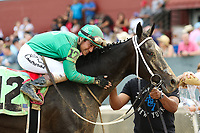 HOT SPRINGS, AR - April 14: Jockey Luis Contreras gives Ever So Clever #12 a hug after winning the Fantasy Stakes at Oaklawn Park on April 14, 2017 in Hot Springs, AR. (Photo by Ciara Bowen/Eclipse Sportswire/Getty Images)