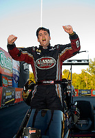 Sept. 19, 2010; Concord, NC, USA; NHRA top fuel dragster driver Larry Dixon celebrates after winning the O'Reilly Auto Parts NHRA Nationals at zMax Dragway. Mandatory Credit: Mark J. Rebilas-