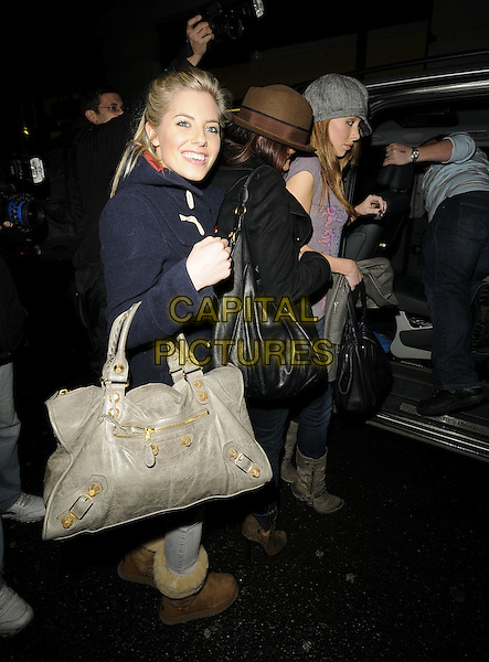MOLLIE KING, VANESSA WHITE & UNA HEALY Of The Saturdays.At the Mayfair Hotel, London, England, UK, 16th January 2010..full length denim skinny jeans grey gray bag  cap hat t-shirt brown bag back coat side suede boots balenciaga uggs ugg getting into car .CAP/CAN.©Can Nguyen/Capital Pictures