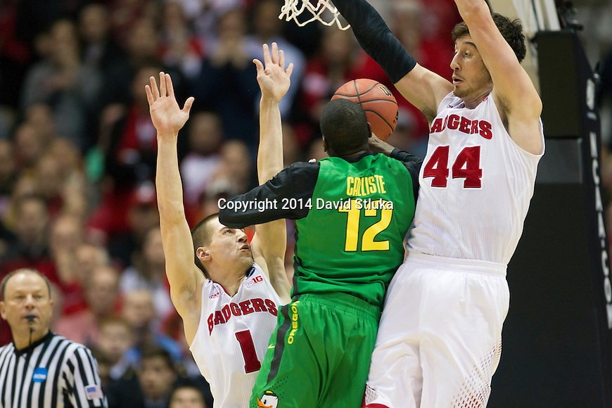 Wisconsin Badgers guard Ben Brust (1) and center Frank Kaminsky (44) defend against Oregon Ducks guard Jason Calliste (12) during the third-round game in the NCAA college basketball tournament Saturday, April 22, 2014 in Milwaukee. The Badgers won 85-77. (Photo by David Stluka)