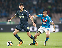 Calcio, Serie A: Napoli, stadio San Paolo, 21 ottobre 2017.<br /> Inter's Matias Vecino (l) in action with Napoli's captain Marek Hamsik (r) during the Italian Serie A football match between Napoli and Inter at Napoli's San Paolo stadium, October 21, 2017.<br /> UPDATE IMAGES PRESS/Isabella Bonotto