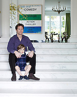 Trevor and Johnny Traina on the marble steps in the entrance hall of their San Francisco home