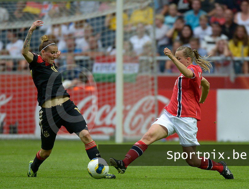 20130728 - Solna , Sweden : German Anja Mittag (l) pictured with Norway Kristine Hegland (r) during the female soccer match between Germany and Norway , in the final of the UEFA Women's Euro Championship 2013  at the Friends Arena  , Solna Stockholm . Sunday 28th July 2013. PHOTO DAVID CATRY