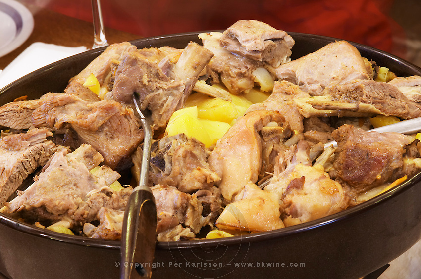 A traditional dish of lamb served in a pot where it also has cooked together with potatoes and other vegetables. In the restaurant and wine bar at the winery. Podrum Vinoteka Sivric winery, Citluk, near Mostar. Federation Bosne i Hercegovine. Bosnia Herzegovina, Europe.