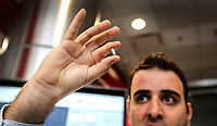 April 11 2019. San Diego, CA. USA|  Qualcomm's Staff Engineer Guilherme Brighenti shows 5G antenna that goes in phones. | Photos by Jamie Scott Lytle. Copyright.