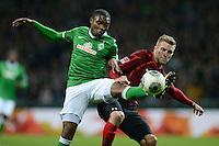 FUSSBALL   1. BUNDESLIGA   SAISON 2013/2014   11. SPIELTAG SV Werder Bremen - Hannover 96                         03.11.2013 Cedrick Makiadi (li, SV Werder Bremen) gegen Andre Hoffmann (re, Hannover)