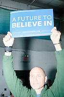 """JD Leedham, of Peterborough, holds a sign reading """"A Future To Believe In"""" while Vermont senator and Democratic presidential candidate Bernie Sanders speaks to senior citizens at the Peterborough Community Center gymnasium in Peterborough, New Hampshire."""