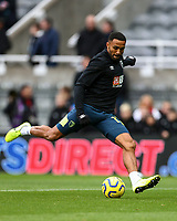 9th November 2019; St James Park, Newcastle, Tyne and Wear, England; English Premier League Football, Newcastle United versus AFC Bournemouth; Callum Wilson of AFC Bournemouth shoots in the warm up - Strictly Editorial Use Only. No use with unauthorized audio, video, data, fixture lists, club/league logos or 'live' services. Online in-match use limited to 120 images, no video emulation. No use in betting, games or single club/league/player publications