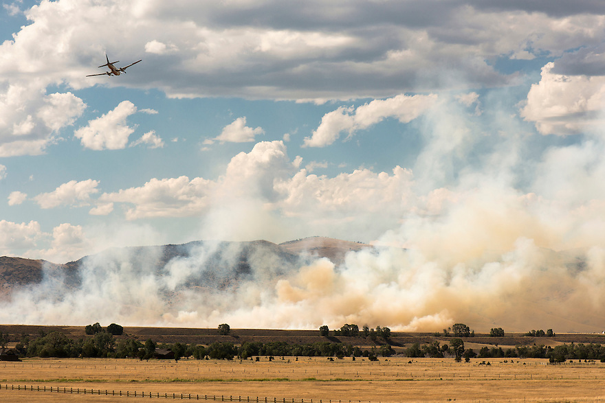 A plane approaches to drop retardant on a wildfire burning in Paradise Valley near Emigrant, Montana.